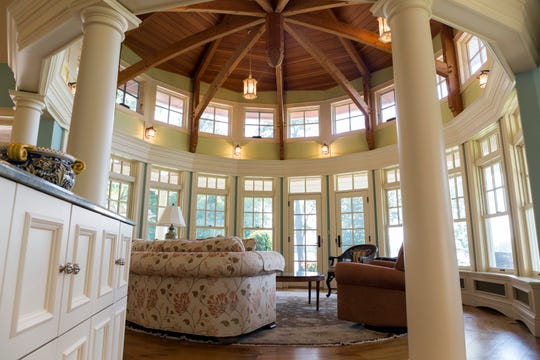 Nine-sided rotunda gives a panoramic view of the pool and Cavanaugh Lake, with columns and arches surrounding the circle. Designing and building the compound took two years.