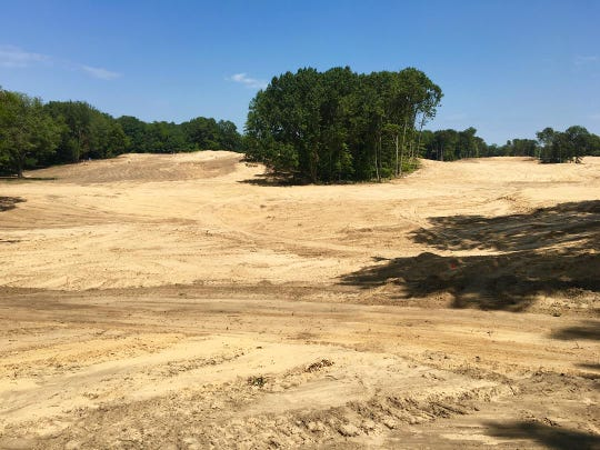 With most former trees removed from the tee at No. 5 of American Dunes in Grand Haven going up the left side, players can also see the seventh hole coming toward them on the right.