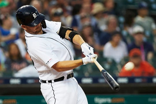 Detroit Tigers catcher Jake Rogers hits a two-run home run in the fourth inning against the Seattle Mariners at Comerica Park, Aug. 13, 2019.