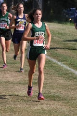Jennifer Ohlsson races in the 2018 Golden Grizzlies High School Invite.