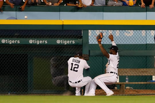 Tigers left fielder Brandon Dixon, left, and center fielder Niko Goodrum run into each other after Goodrum misplayed a two-run home run by Mariners third baseman Kyle Seager during the ninth inning of the Tigers' 11-6 loss on Tuesday, Aug. 13, 2019, at Comerica Park.