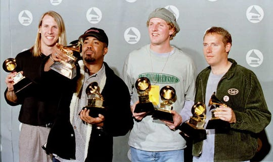 Hootie & the Blowfish pose for photographers with their Grammys for best new artist and best group pop performance at the 38th Annual Grammy Awards in Los Angeles, February 28, 1996.