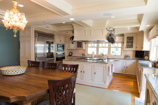 All cabinets in this top-of-the-line kitchen as well as throughout  the house were hand-built by a Michigan craftsman. The appliances are commercial grade. To facilitate serving buffets, 55 lineal feet of counter, not all shown, are wrapped around the kitchen.
