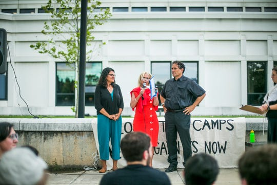 Members of congress Rashida Tlaib, Debbie Dingell, and Andy Levin speak at a protest at the Dearborn Police Department headquarters calling on the law enforcement agency to end its voluntary cooperation with ICE.