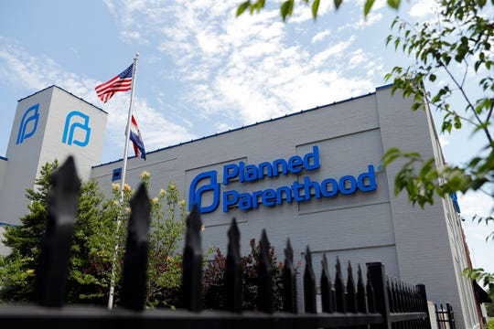 In this June 4, 2019, file photo, a Planned Parenthood clinic is photographed in St. Louis. Planned Parenthood says it will leave the federal family planning program by Monday, Aug. 19, unless a court puts a hold on Trump administration rules that bar clinics from referring women for abortions.
