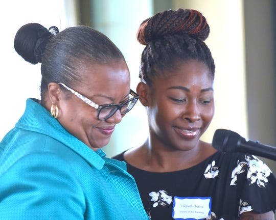 Prosecutor Kym Worthy, left, introduces sexual assault survivor Elle Travis, of Detroit, before she speaks and recites a poem at an event Wednesday to commemorate the 10th anniversary of the Wayne County Prosecutor's Office Sexual Assault Kit Initiative at the Guardian Building in Detroit.