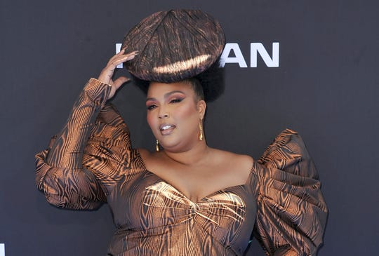 "Detroit-born musician Lizzo arrives at the BET Awards at the Microsoft Theater in Los Angeles. Lizzo's breakthrough hit ""Truth Hurts"" is a two-year-old song, but it still has a chance at the 2020 Grammys."