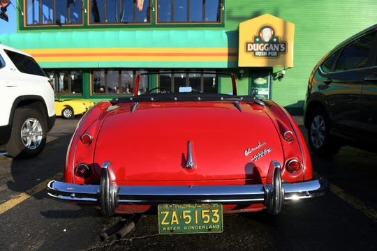 A 1959 Austin Healey is among the cars parked at Duggan's Irish Pub in Royal Oak, Mich. on Aug. 7, 2019.   The pub has been a gathering spot for cruisers to show off their rides since the Woodward Dream Cruise's inception 25 years ago.
