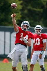 Michigan State quarterback Brian Lewerke, left, throws a pass during a practice earlier this week.