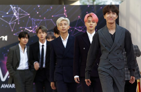 Members of South Korean K-Pop group BTS arrive to attend The Fact Music Awards in Incheon, South Korea on Aug. 12, 2019. A South Korean entertainment agency says the group is taking an extended break.