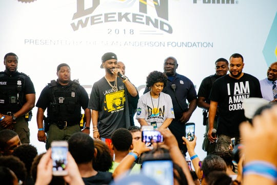 Big Sean (center left) and his mother, Myra Anderson (center right) at the inaugural D.O.N. Weekend in 2018.