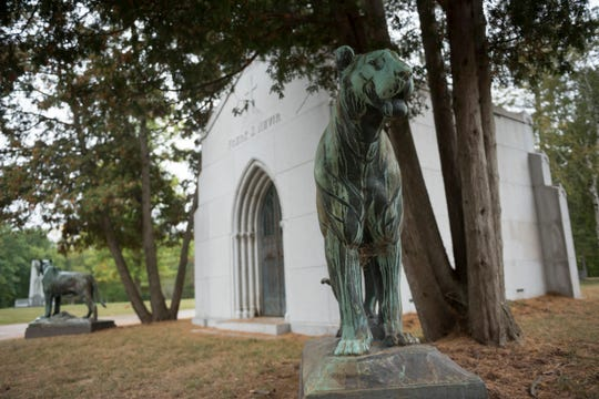 Bronze statues of tigers stand outside the private mausoleum of Frank Navin, former owner of the Detroit Tigers, at Holy Sepulchre cemetery in Southfield.