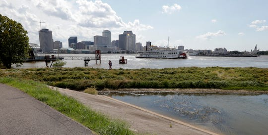 A levee revetment in the flooded batture, bottom right, of Algiers Point on the Mississippi River in New Orleans.  The river that drains much of the flood-soaked United States is running far higher than normal this hurricane season, menacing New Orleans in multiple ways.