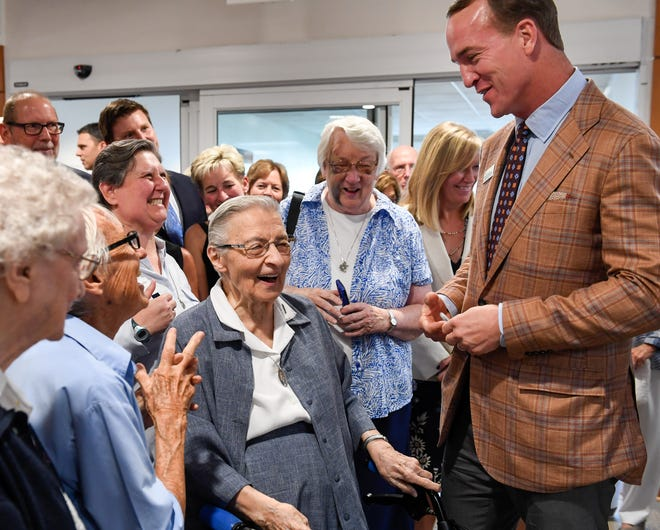 Special guest Peyton Manning shares a laugh with Sister Mary John Tintea after signing an autograph for her following a press conference announcing a collaboration between Evansville's St. Vincent Hospital and the Peyton Manning Children's Hospital for a new Peyton Manning Children's Hospital Emergency Room for Children in Evansville Wednesday, August 14, 2019.