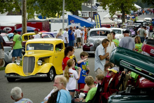 Hot rods cruise the loop during the 2015 Frog Follies at the Vanderburgh County 4-H Fairgrounds.