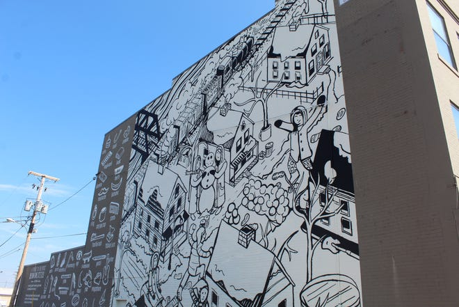 This new mural was completed Aug. 8 on the side of the Brady Mercantile Building in downtown Fremont. Bradley Scherzer teamed up with assistant Ken Dushane III to complete the mural project.