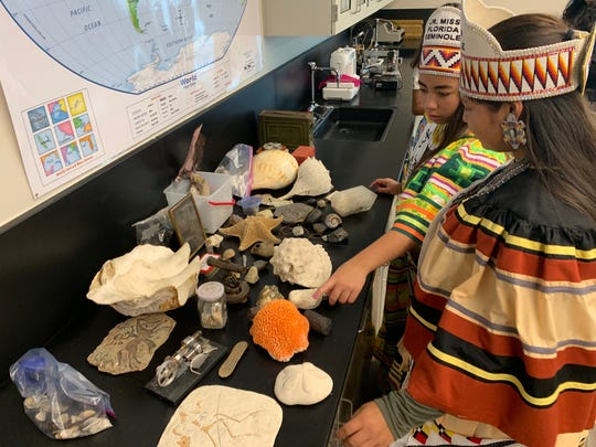 Junior Miss Florida Seminole Aubee Billie and Miss Florida Seminole Alycia Mora, look at shells in the science lab at the Ahfachkee school on the Big Cypress Reservation during a tour Tuesday, Aug. 13 2019.