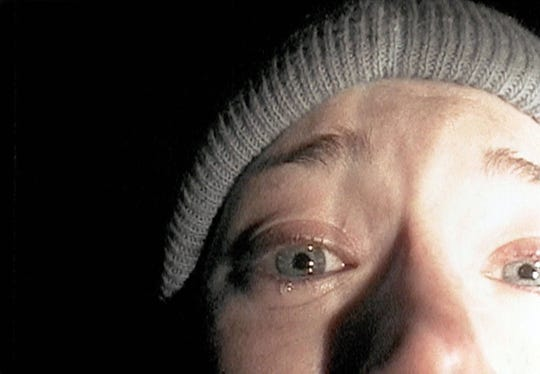 "In a classic image from the groundbreaking horror film  ""The Blair Witch Project,"" Heather Donahue turns the camera on herself for her confession."