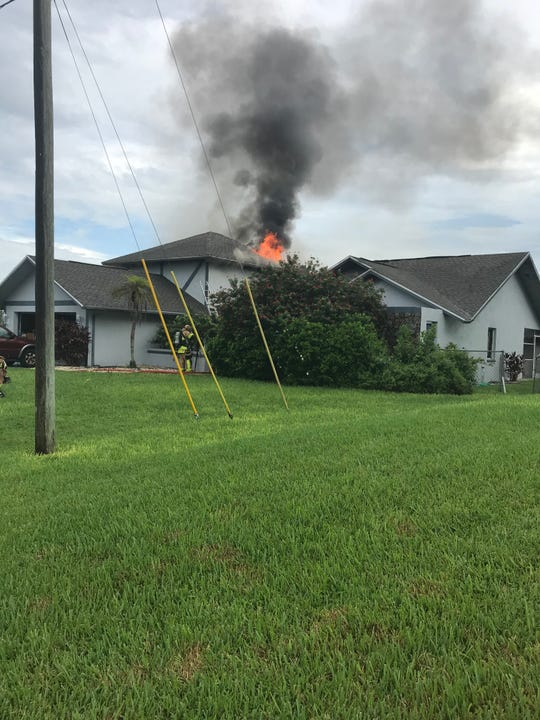 Cape Coral firefighters work to put out the Wednesday morning blaze on NW 2nd Street in Cape Coral, Aug. 14, 2019.