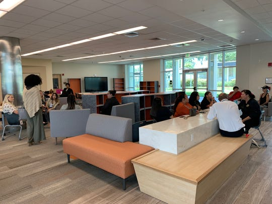 Members of the community lounge in the downstairs seating area at the new Ahfachkee school on the Big Cypress Reservation during a tour Tuesday, Aug. 13 2019.