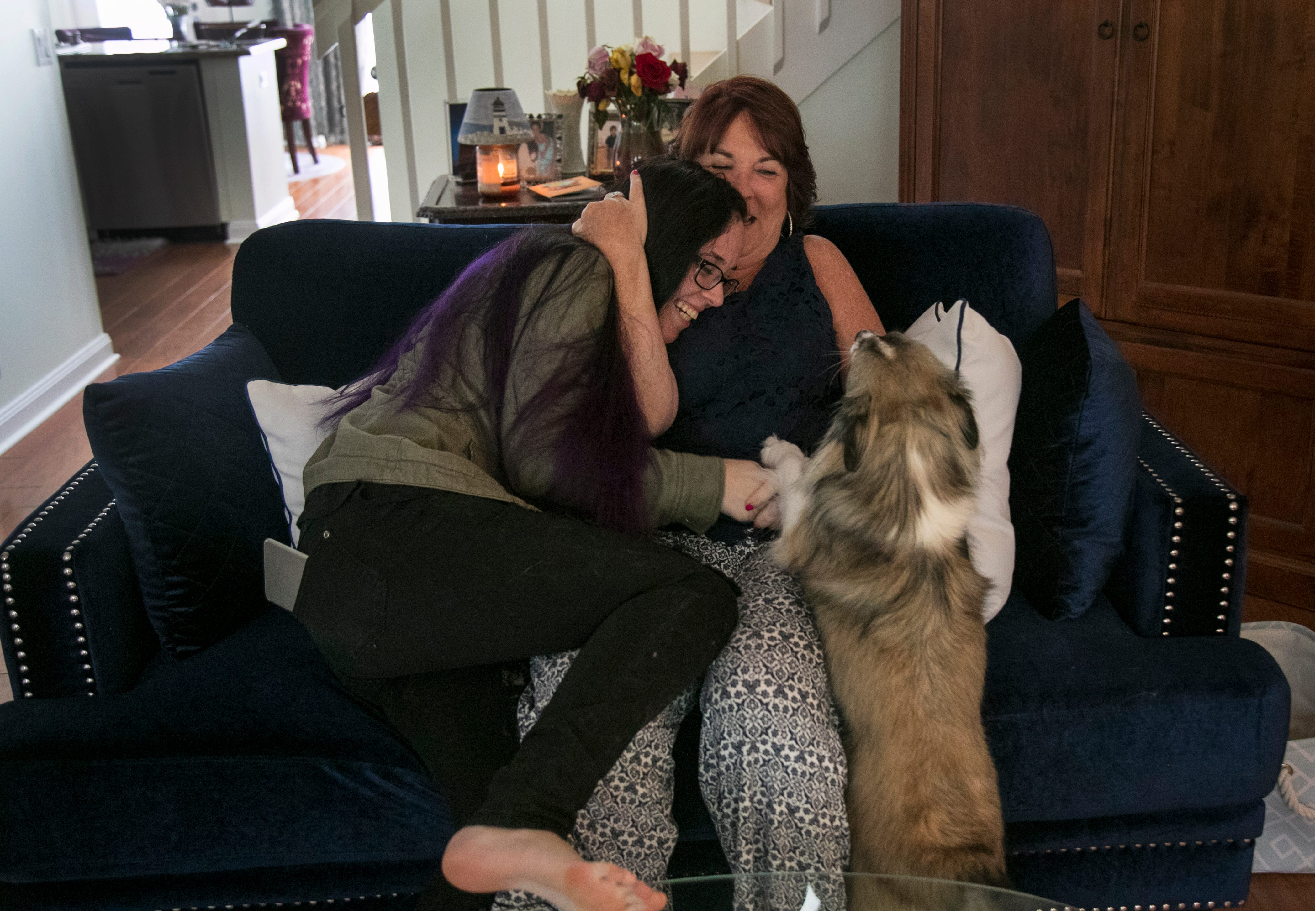 Karen Doherty and her daughter Sarah laugh together in their Naples home last year. Sarah was twice sent to The David Lawrence CenterÕs crisis stabilization unit under the Baker Act. But her stays there led her to a therapist she trusted, and she now has an improved outlook on life.