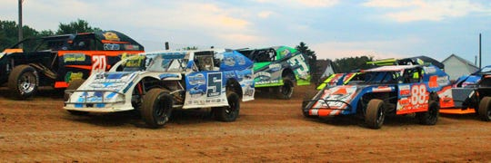 Josh Lambert (5) leads Josh Long (88) and a pack of IMCA Modifieds through the corner at Luxemburg Speedway during the July 26 racing program.