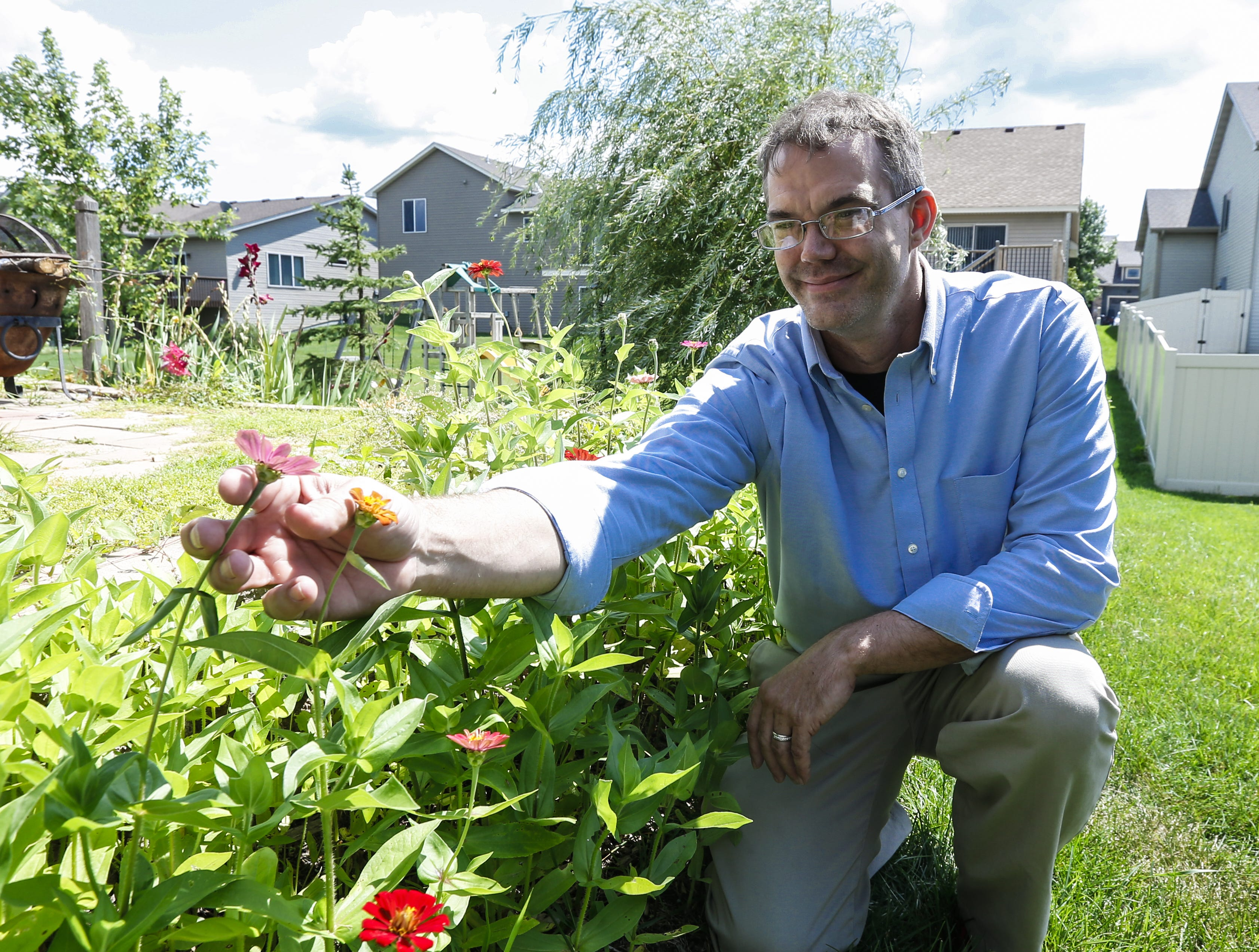 Nate Lindstrom works on his garden in August 2019 at his house in Ramsey, Minn.