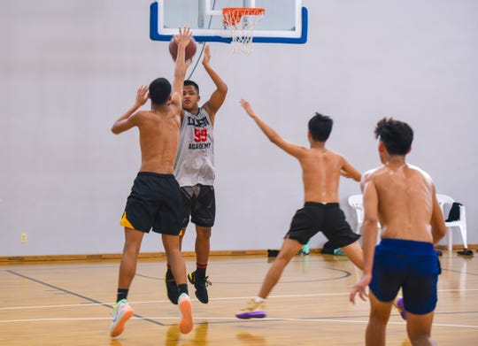 Guard Elijah Garrido goes up for a shot as he and other members of Guam's boys' FIBA U17 team practice at the Guam Basketball National Training Center in Tiyan on Thursday, Aug. 15, 2019. The team is preparing to compete at the FIBA U17 Oceania Championship, scheduled to be held Aug. 18 through Aug. 24 in Noumea, New Caledonia.