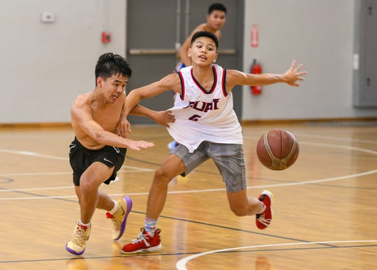 Colin Santiago, left, pressures EJ Cruz during his drive, as he and other members of Guam's boys' FIBA U17 team engage in a practice game at the Guam Basketball National Training Center in Tiyan on Thursday, Aug. 15, 2019. The team is preparing to compete at the FIBA U17 Oceania Championship, scheduled to be held Aug. 18 through Aug. 24 in Noumea, New Caledonia.