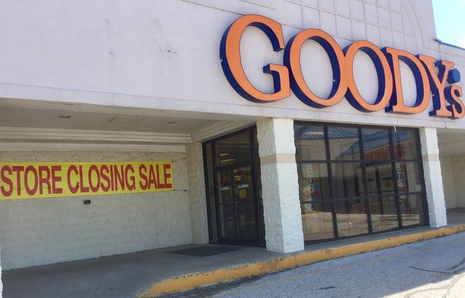"A banner advertising a ""Store Closing Sale"" is posted outside of the Henderson Goody's location."