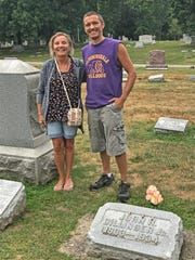 Hedi Dooley, 59, and son Matt, 31, of Rockville Ind., formerly of Indianapolis at the John Dillinger grave at Crown Hill Cemetery in Indianapolis on Aug. 12, 2019.