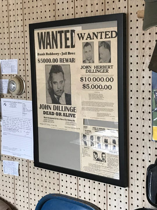 Reprint of the FBI wanted poster that features John Dillinger on the walls of the Morz/Pedigo Plumbing Service at 135 W. High St in Mooresville. Was once the grocery store whose owner, Frank Morgan, Dillinger robbed.