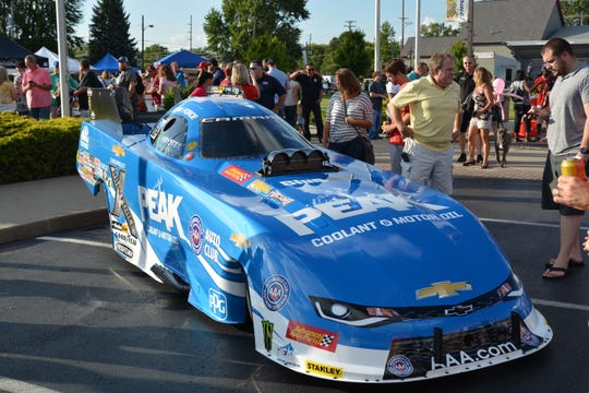 NHRA drag racing fans check out a hot rod during the Big Go Block Party in Brownsburg.