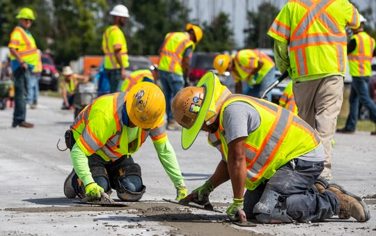Workers use approximately 900 linear feet of concrete to fill all of the holes marked for repair along the closed section of I-465 on Wednesday, Aug. 14, 2019.