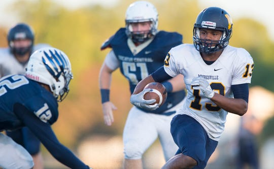 Mooresville's Brayden Evans (13) looks for a hole in the Decatur Central defense during the first half of action.