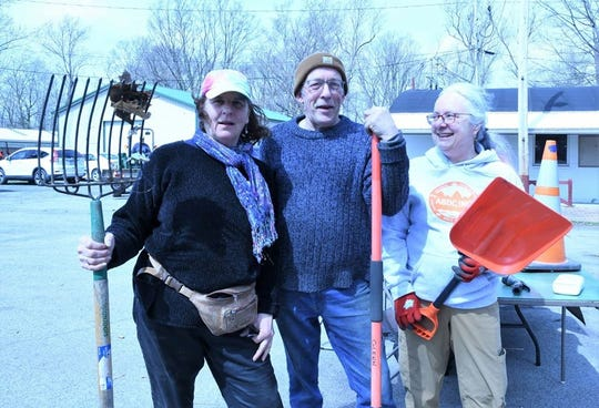 Blacksmith and artist Durand Van Doren is flanked by nurse and musician Mary Ott, and CPA and Rotarian Mary Bouchard as they take a break from planting Rotary trees at the Trumansburg Fairgrounds.