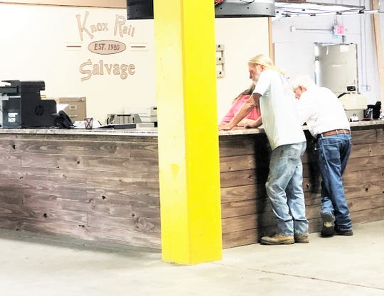 Knox Rail Salvage store manager April Smith looks up products and pricing for two customers at the new Fountain City store.