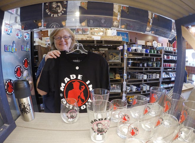 Heart of Michigan owner Karen Wing holds a T-shirt Wednesday, Aug. 14, 2019, one of a number of Made in Detroit products the downtown Howell store now carries.
