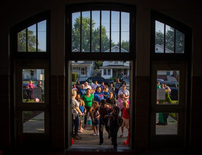 Students make their way inside Semple Elementary School on the first day of school. Aug. 14, 2019
