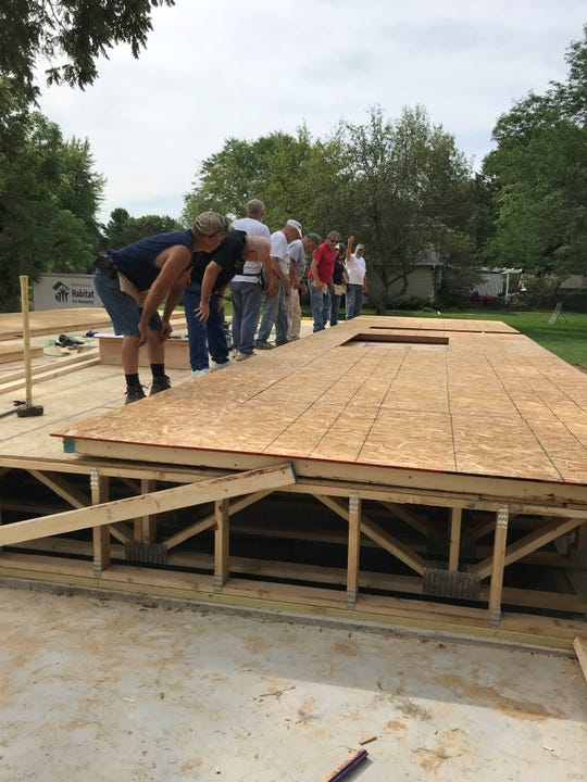Habitat for Humanity volunteers build a home in Marshfield Saturday, August 10, 2019.