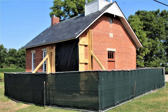 Fencing is in place around Linn School, located on Ohio 4 north of Marion. The historic structure was badly damaged when it was struck by a semi on July 30. Crews from Quality Masonry Company, Inc. also reinforced the walls and covered the gaping hole in the southeast corner of the 122-year old building owned by the Marion County Historical Society.
