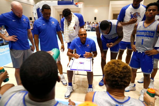 Memphis Tigers Head Coach Penny Hardaway talks to his team in a huddle during their exhibition game against the Commonwealth Bank Giants at the Grand Hyatt Baha Mar's New Providence Ballroom on Wednesday, August 14, 2019.