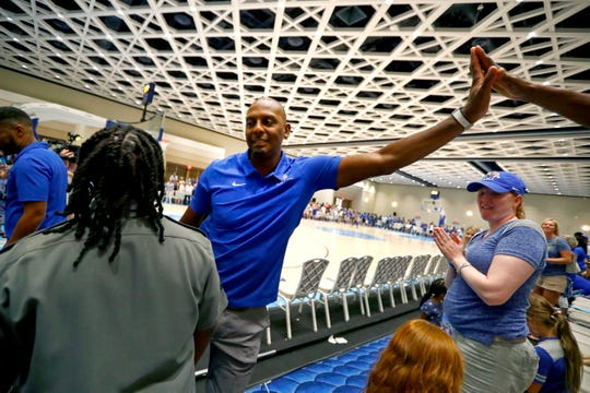 Memphis Tigers Head Coach Penny Hardaway high-fives fans after their win against the Commonwealth Bank Giants during their exhibition game at the Grand Hyatt Baha Mar's New Providence Ballroom on Wednesday, August 14, 2019.