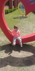 Cooper Kilburn sits outside Le Bonheur Children's Hospital in Memphis in April.