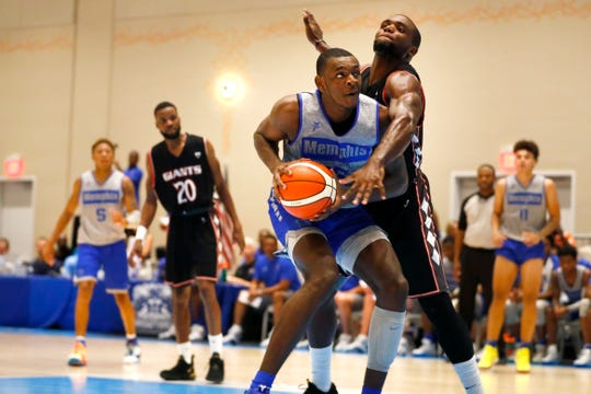 Memphis Tigers forward Lance Thomas is fouled against the Commonwealth Bank Giants during their exhibition game at the Grand Hyatt Baha Mar's New Providence Ballroom on Wednesday, August 14, 2019.