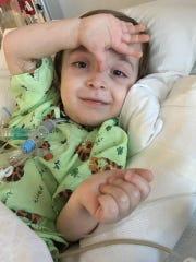 Cooper Kilburn lies in a bed at Le Bonheur Children's Hospital.