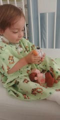 Cooper Kilburn plays with toys before a surgery in June.