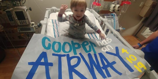 Cooper Kilburn shows off a big smile after doctors performed a procedure to give him an airway in April.