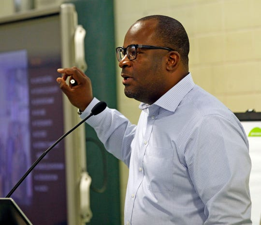 "Reggie Moore, who heads the city's Office of Violence Prevention, talks about Milwaukee's ""Blueprint for Peace"" at a monthly brainstorming session on trauma last year."
