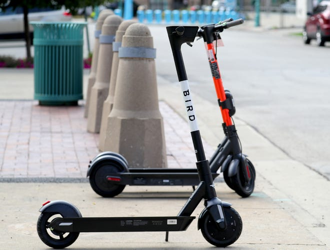 A Spin electric scooter and a Bird scooter in the Third Ward in Milwaukee on Wednesday, Aug. 14, 2019.   - Photo by Mike De Sisti/Milwaukee Journal Sentinel